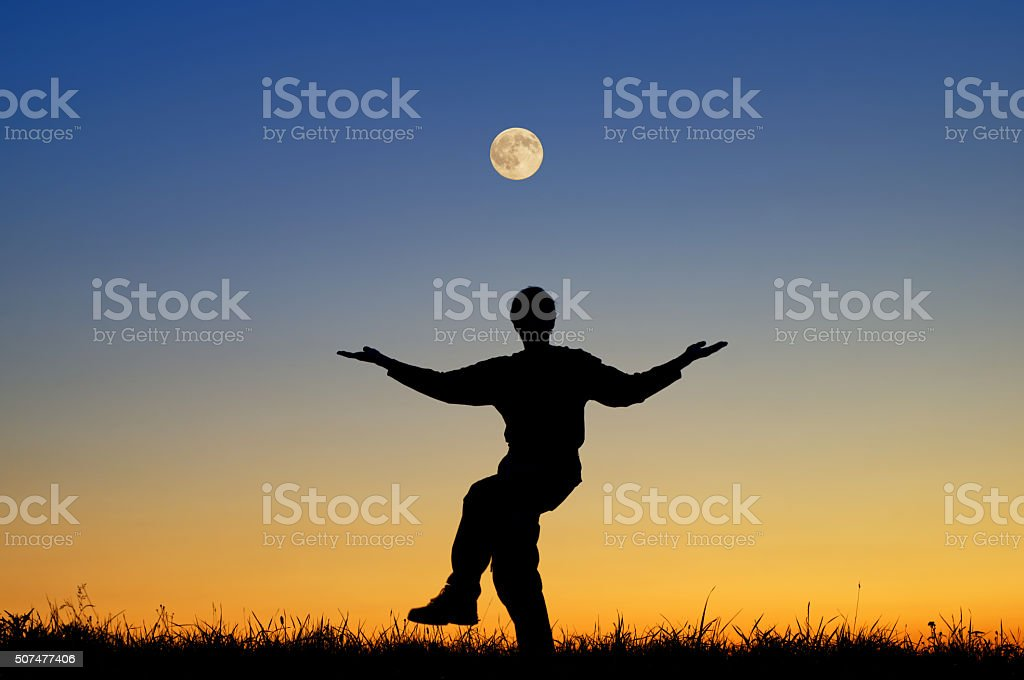 The cosmic dance of Shiva. Silhouette with a full moon. stock photo