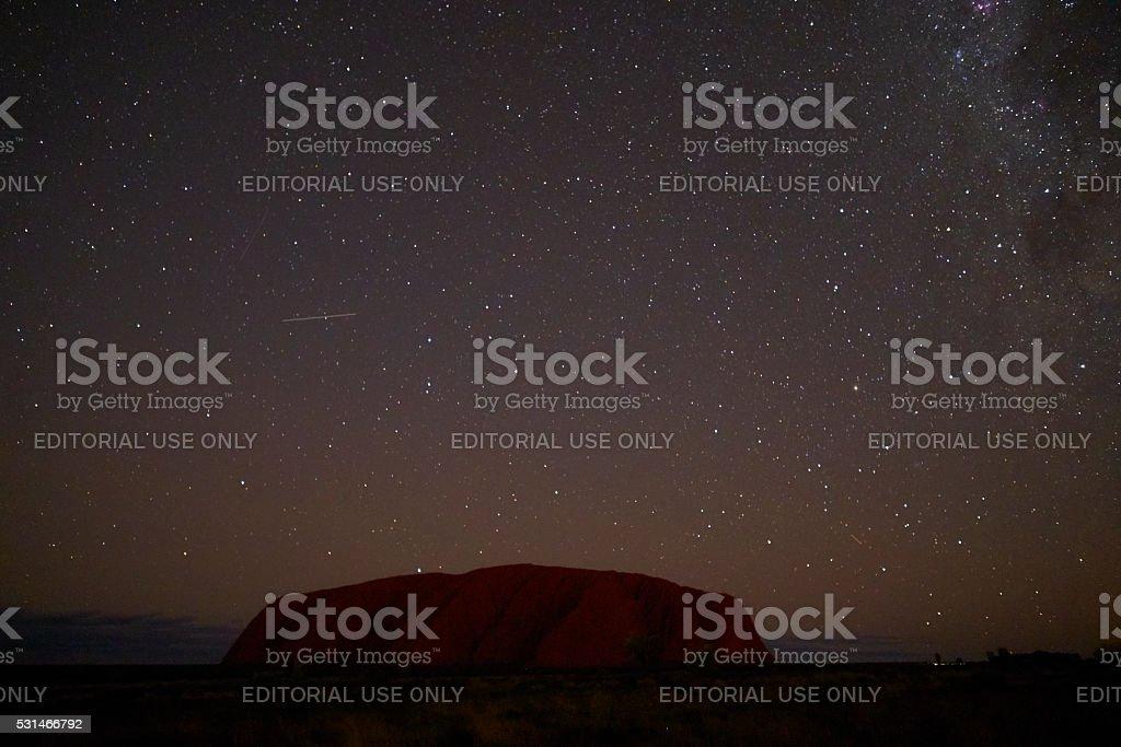 The Cosmos Over Uluru stock photo