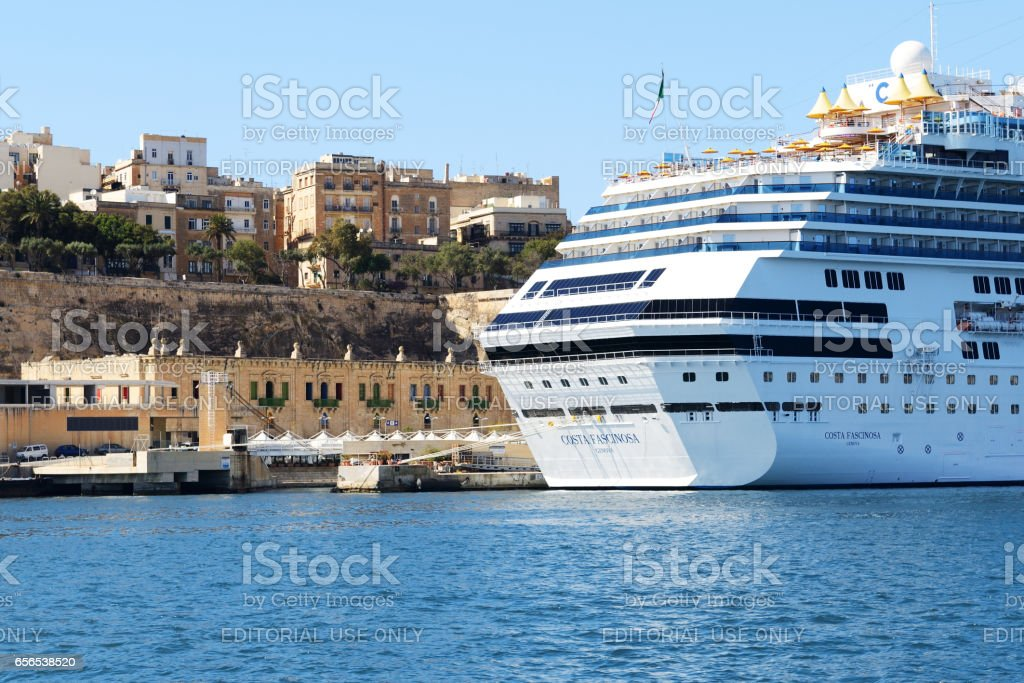 Valletta, Malta - April 22, 2015: The Costa Fascinosa cruise ship with tourists is in harbour. More then 1,6 mln tourists is expected to visit Malta in year 2015. stock photo