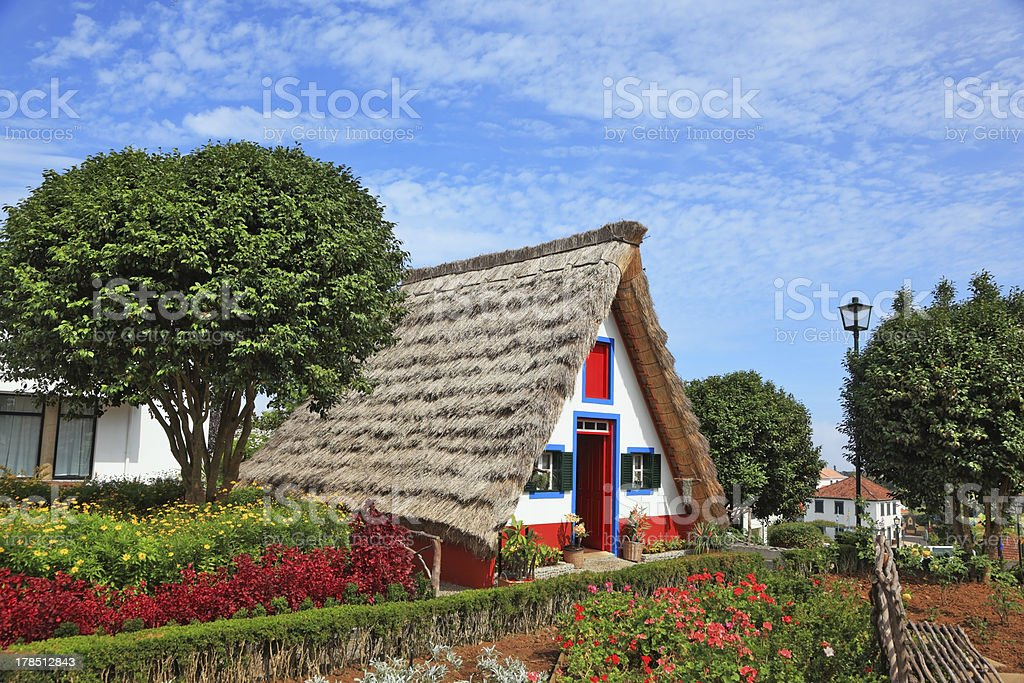 The cottage  and gable small garden with flowers royalty-free stock photo