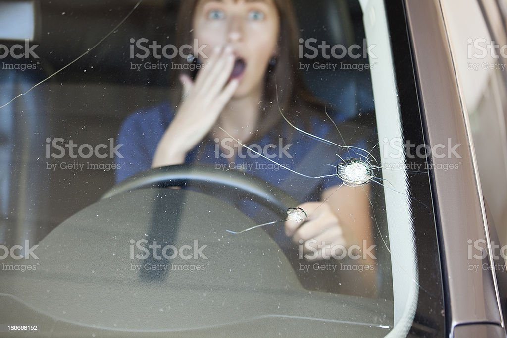The crack in a windshield from a rock stock photo