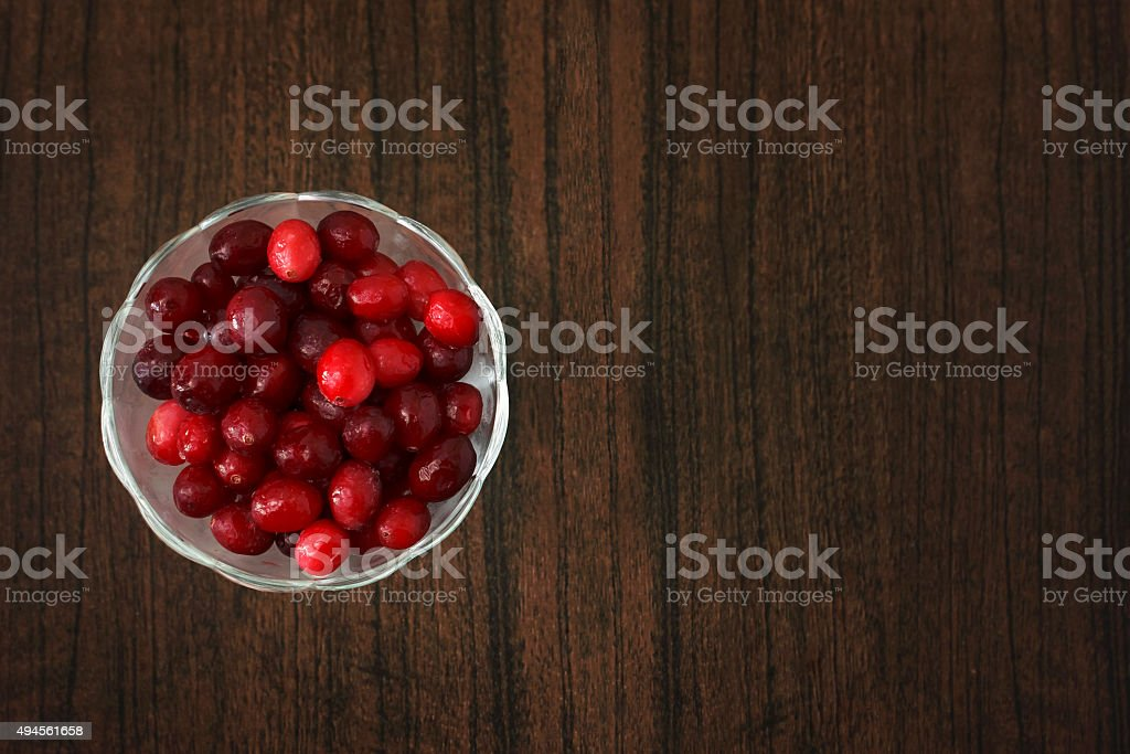 the cranberry on a wooden table stock photo
