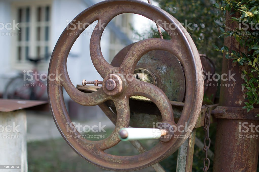 The crank pulley fountain stock photo