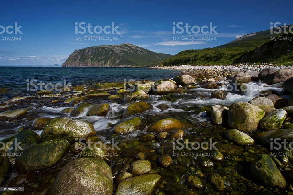 The creek flows into the sea. stock photo