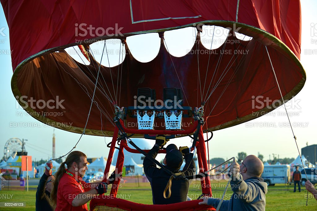 The crew members hold the basket down stock photo