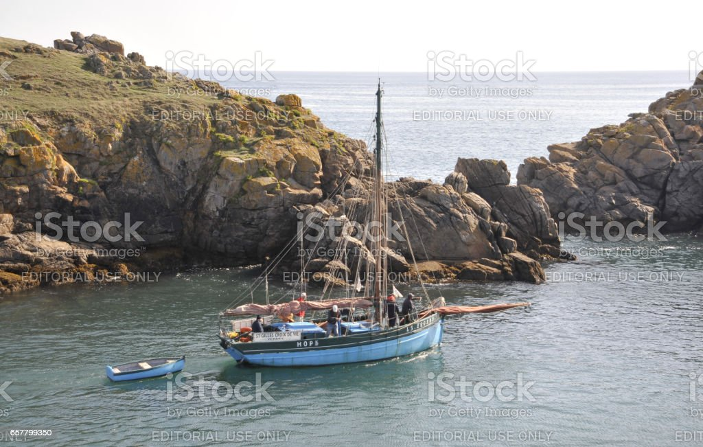 The crew of the 'Hope' leave Meule harbour, Ile d'Yeu, France. stock photo
