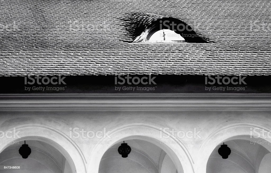 the cross in the dormer window stock photo