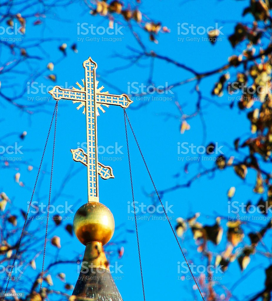 The cross on the dome of the temple stock photo