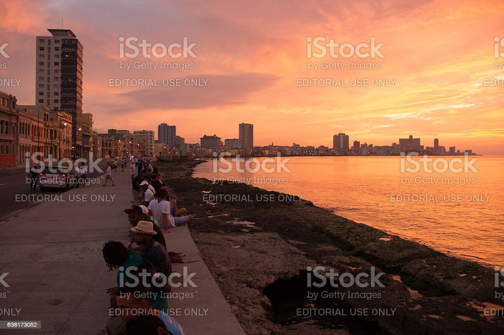 The crowded Cuban Malecon during goldensunset stock photo