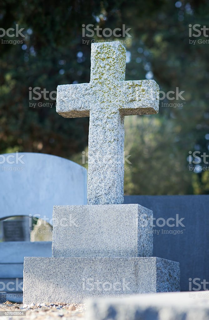 The crucifix is the guardian of this grave stock photo