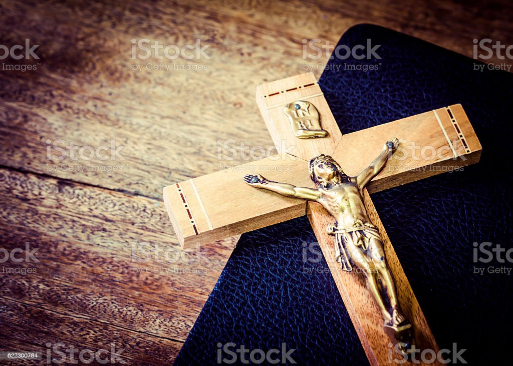 the crucifix on black book stock photo