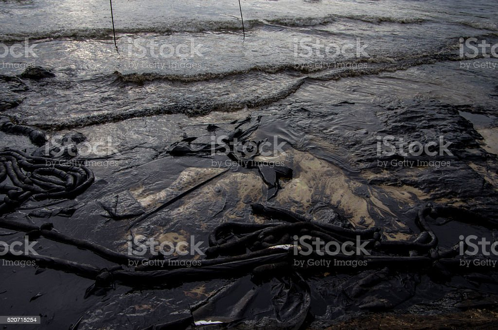 The crude oil on the Ao Proa beach stock photo