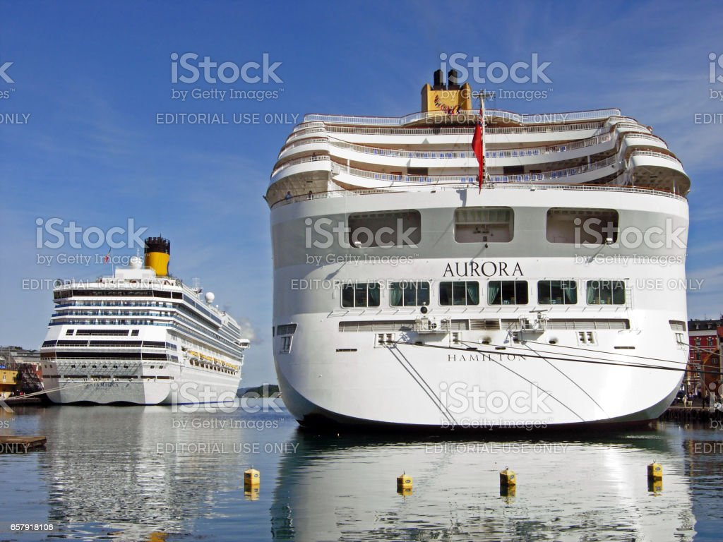 The cruise ships AURORA and Costa Magica have moored at Skagenkaien Pier in the port of Stavanger (Norway) stock photo