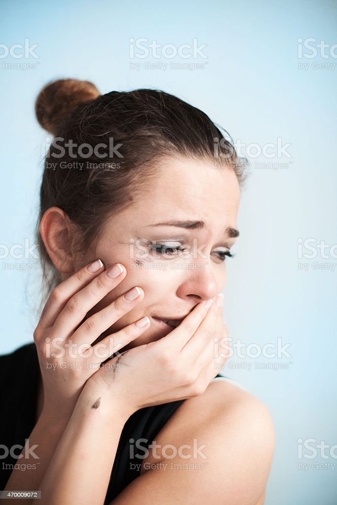 The crying woman is upset stock photo