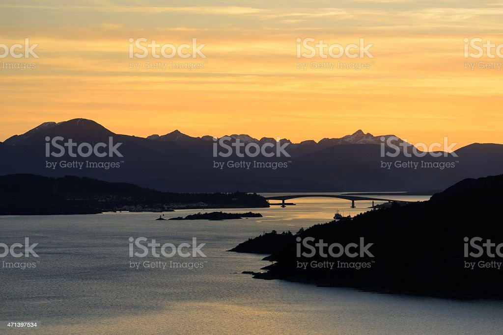 The Cuillins and the Skye bridge at dusk stock photo