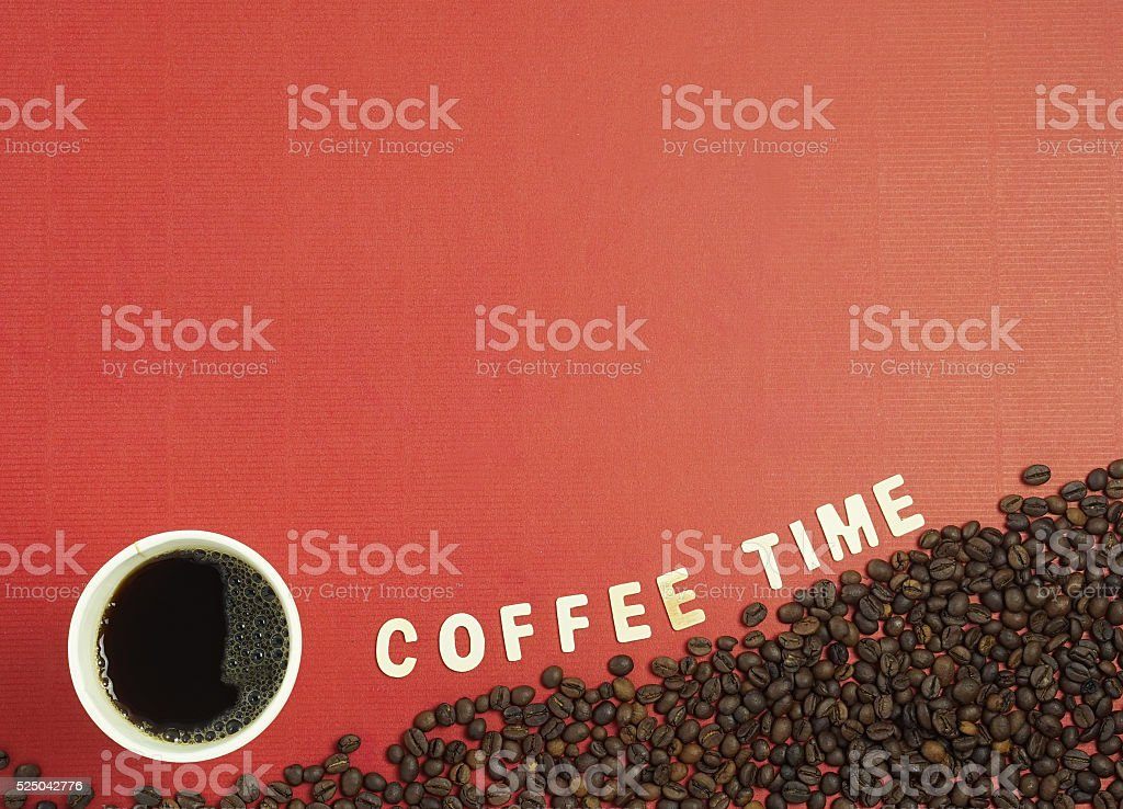 The cup of coffee, coffee time text and coffee beans stock photo