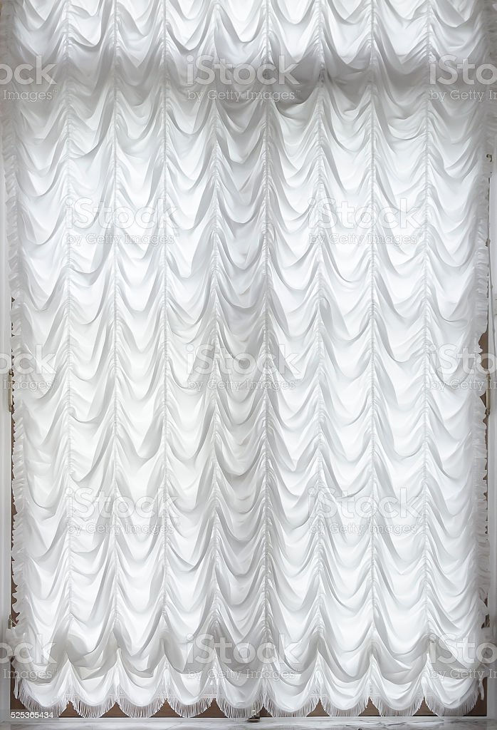 The curtain on the window stock photo