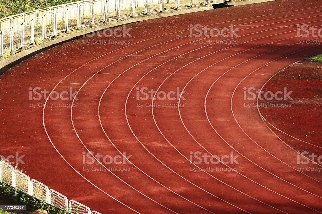 The Curves of an Athletics Track with a Red Surface. royalty-free stock photo