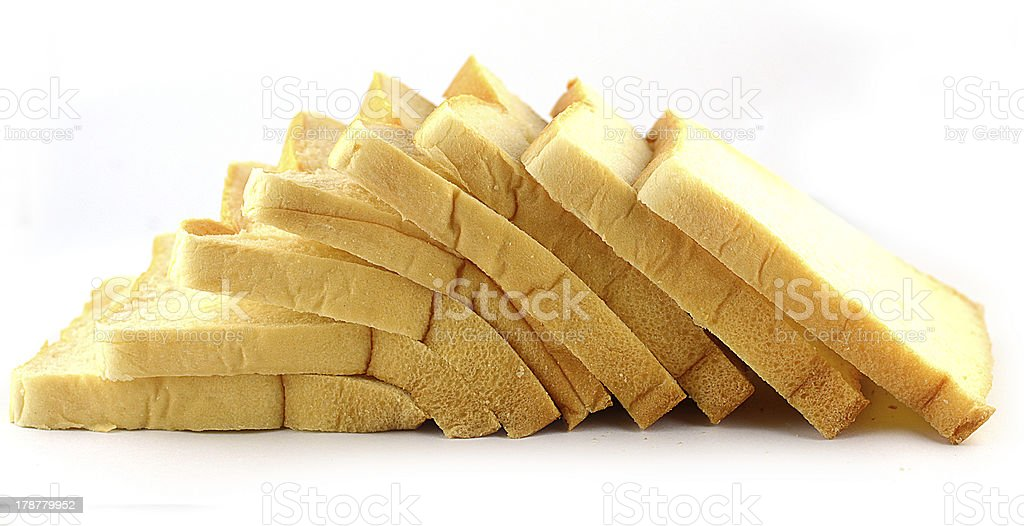 The cut loaf of bread isolated on white royalty-free stock photo