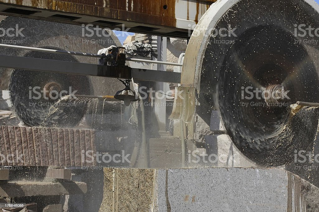 The cutting process in a stone-cutting factory royalty-free stock photo