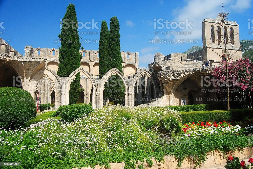 The cypress-lined cloister courtyard at the Bellapais Abbey. stock photo