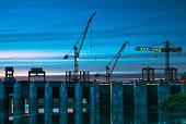 The dam, evening, construction cranes