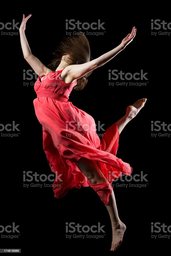 The dancer in midair on black royalty-free stock photo