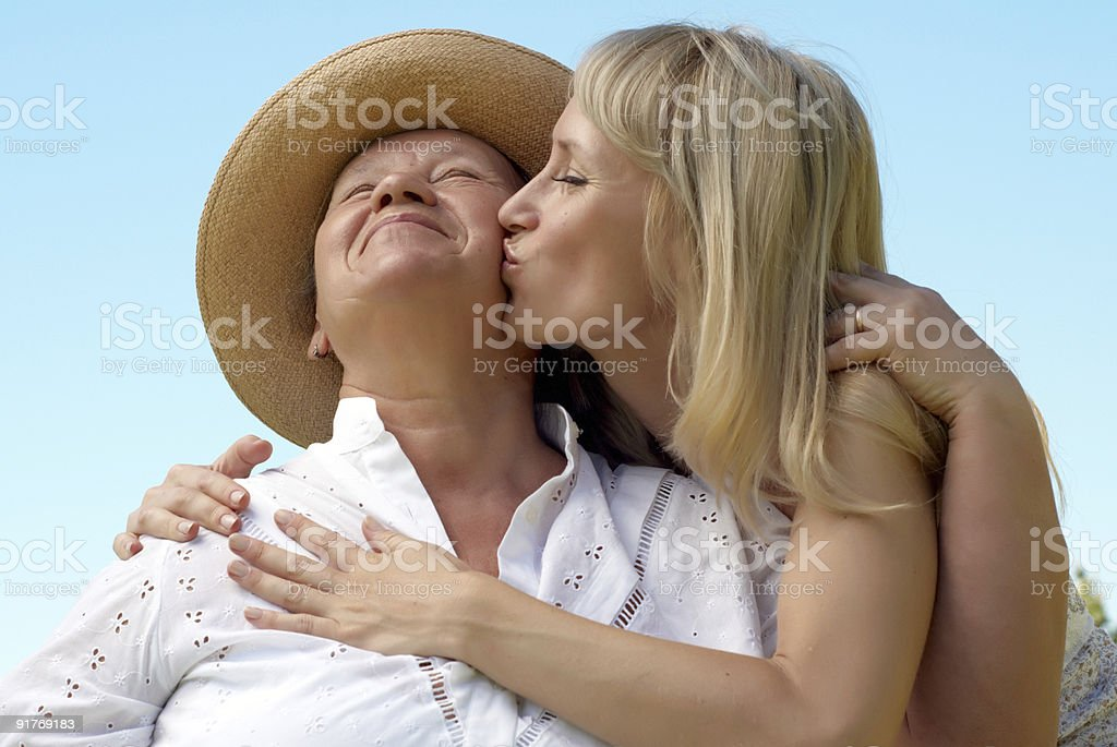 The daughter kissing  mother outdoors royalty-free stock photo