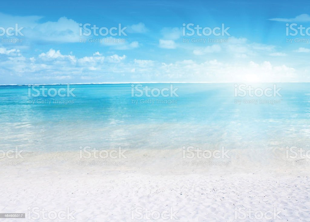 The dawning day on a beach with crystal clear waters  stock photo