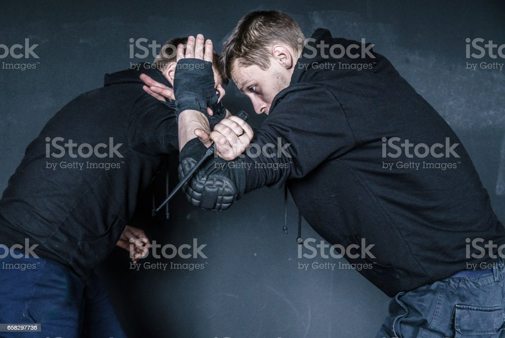 The defense against the knife attack. Krav Maga practice: the self-defense martial art developed for the Israel Army. Minsk, Belarus. stock photo