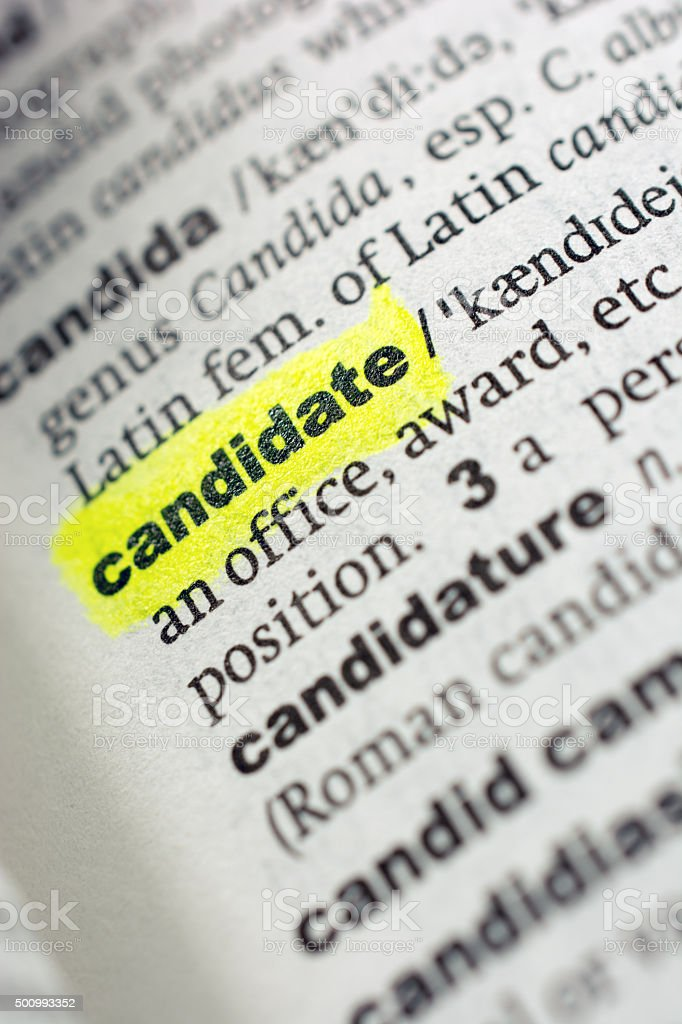 The definition for 'candidate' as shown in the dictionary stock photo