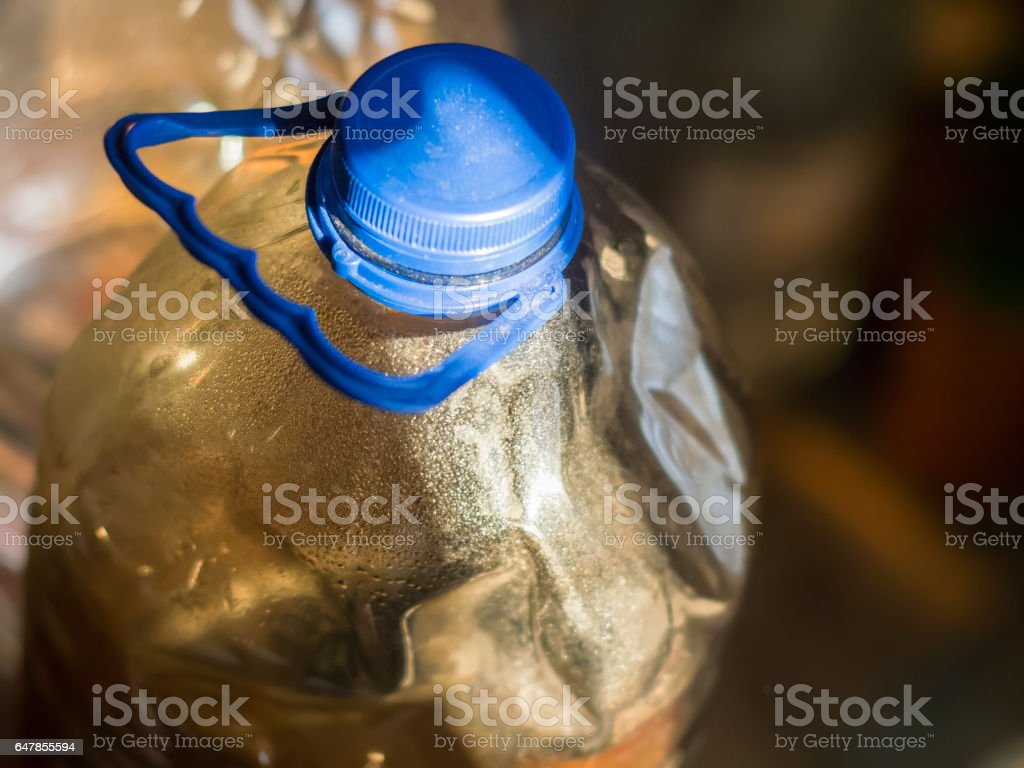 The dented plastic bottle with water stock photo