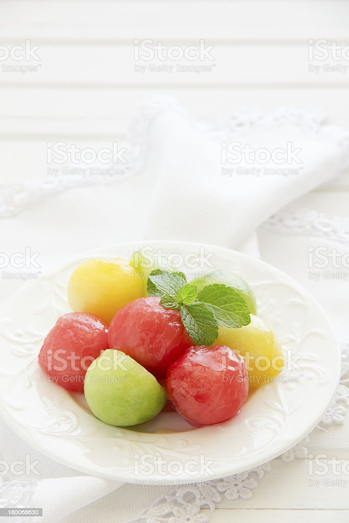 The dessert salad of watermelon and cantaloupe with honey. royalty-free stock photo