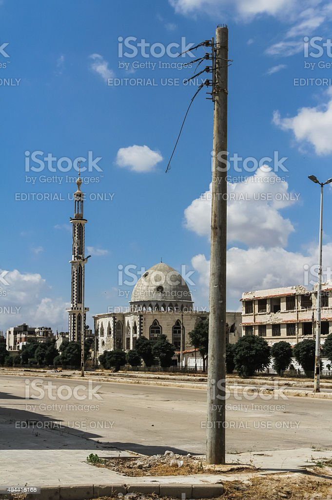 The destruction of mosques and ragged power line in Homs stock photo
