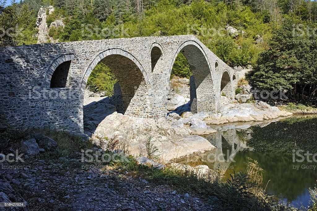 The Devil's Bridge in Arda river and Rhodopes mountain, Bulgaria stock photo