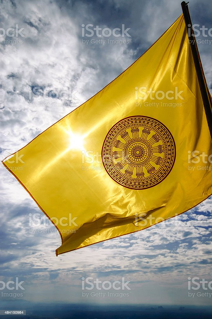 The Dharmachakra flag, symbol of Buddhism in Thailand stock photo
