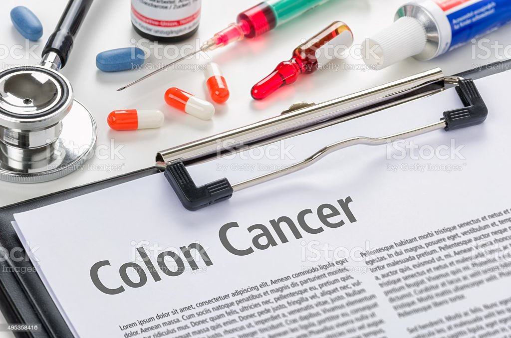The diagnosis Colon Cancer written on a clipboard stock photo