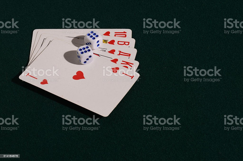 The dice and playing cards  on green broadcloth. stock photo
