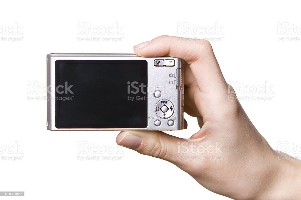 The digital camera in a hand royalty-free stock photo