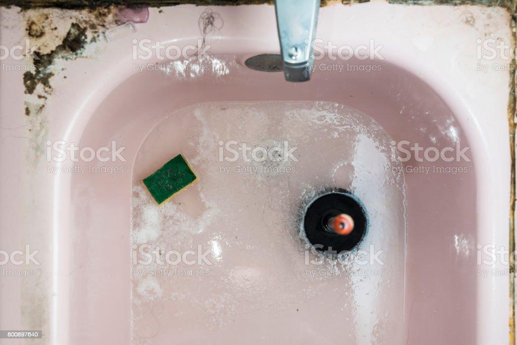 The Dirty Messy Clogged Bathtub Royalty Free Stock Photo