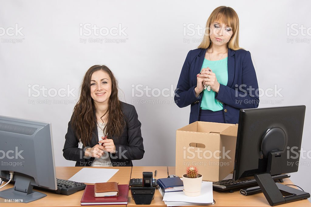 The dismissal of colleagues is joy in the office employee stock photo