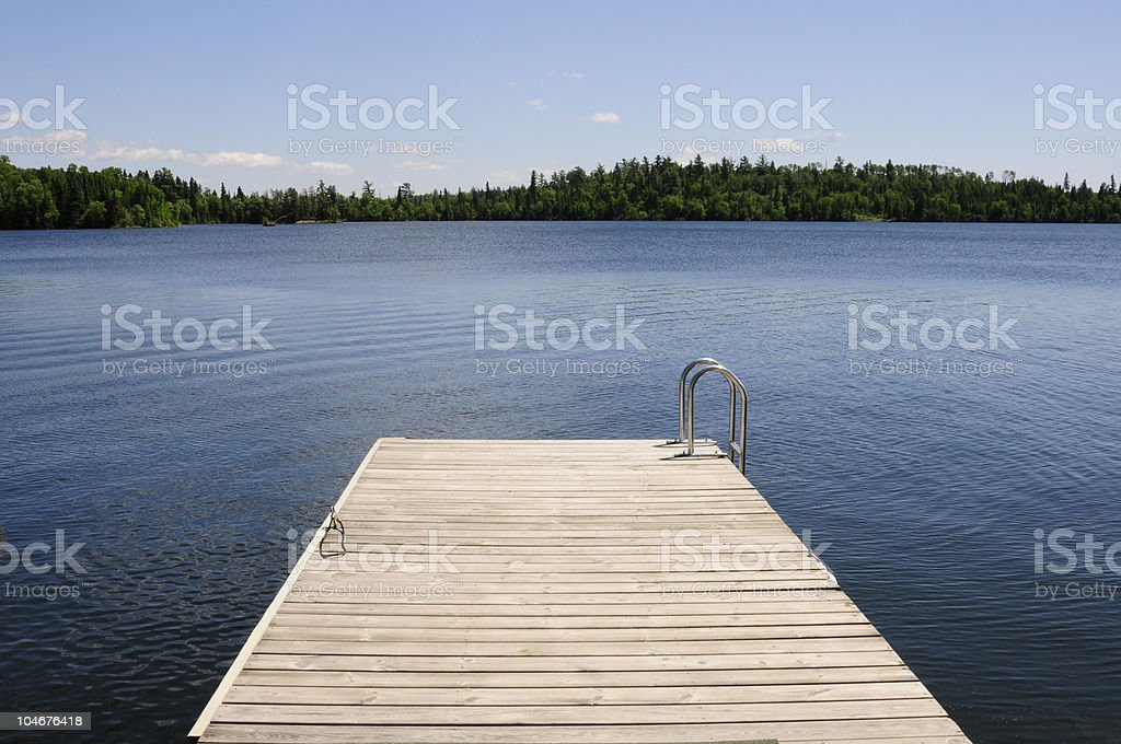 The dock on a gorgeous summer day - horizontal royalty-free stock photo