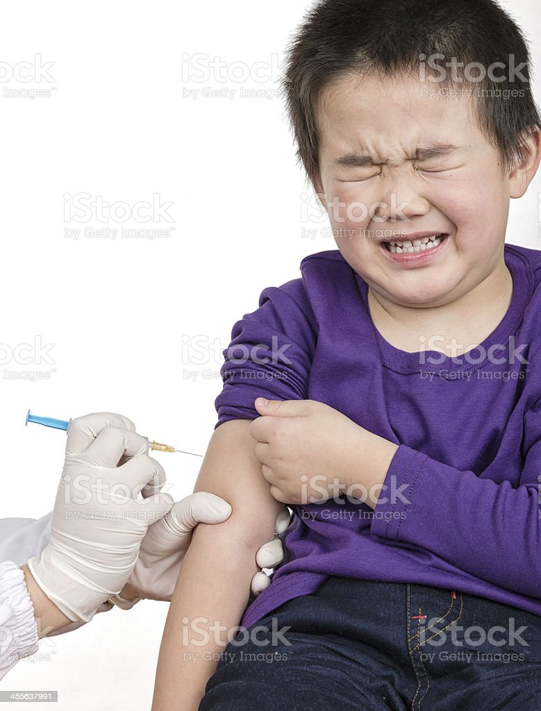 The doctor gave children vaccination needle stock photo