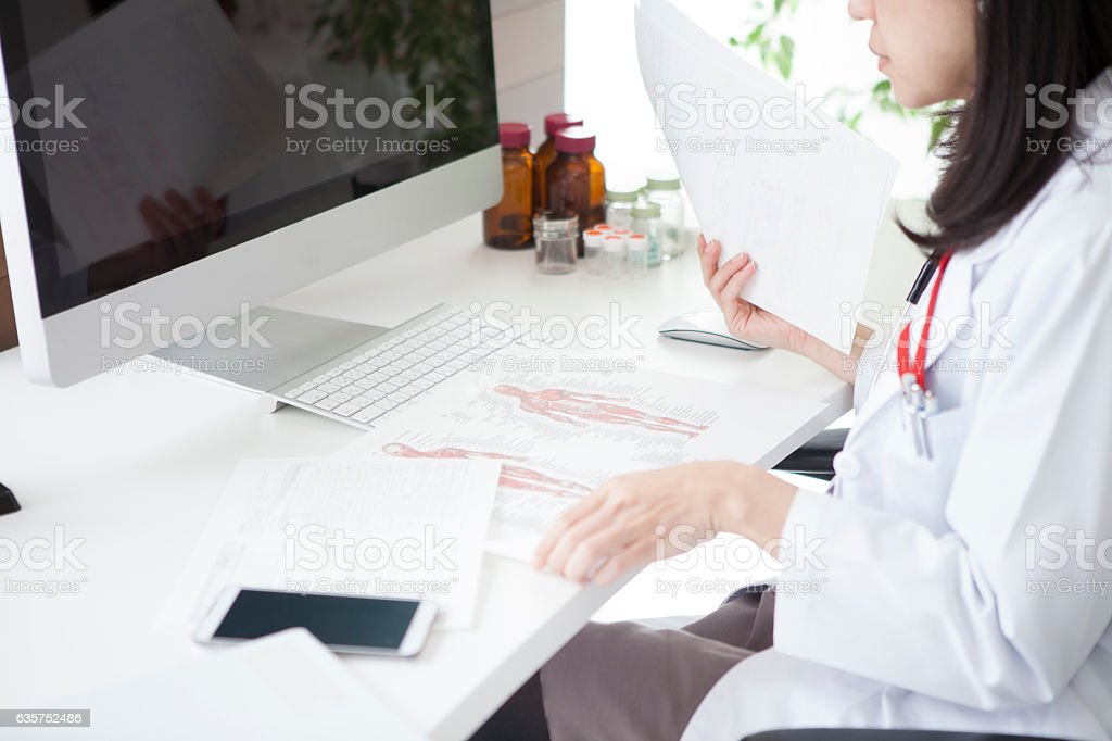 The doctor is looking at the material. stock photo