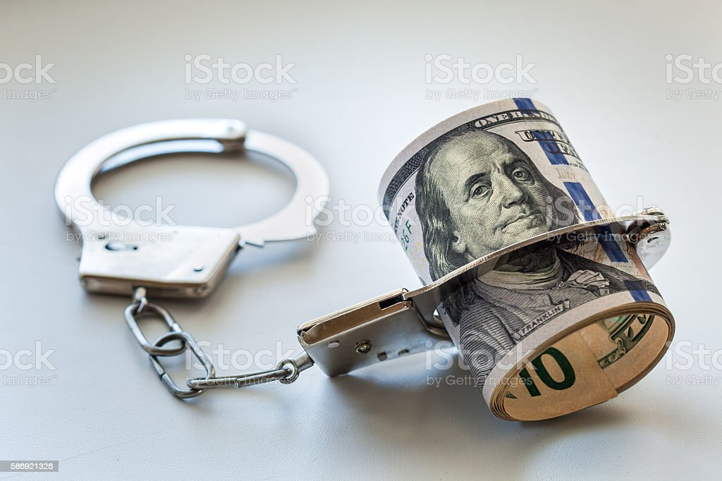 The dollars and handcuffs. stock photo