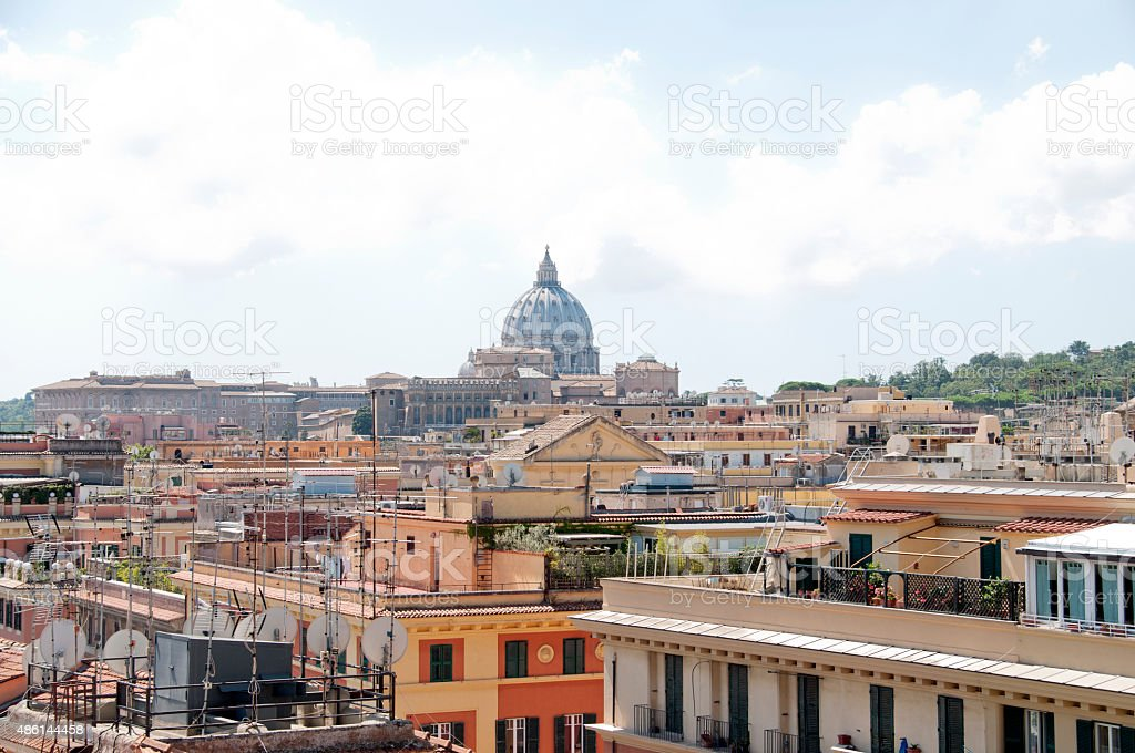 The dome of St. Peter's and the roofs of Rome stock photo