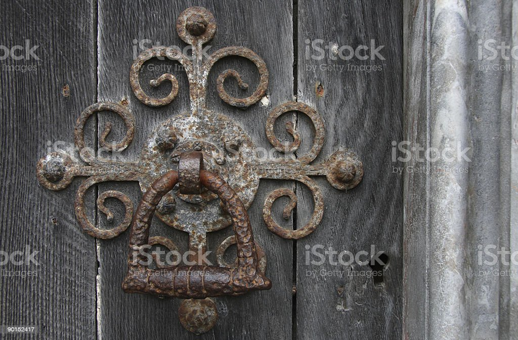 The door handle on an medieval church royalty-free stock photo