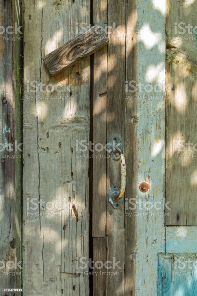 The door of the old wooden barn stock photo