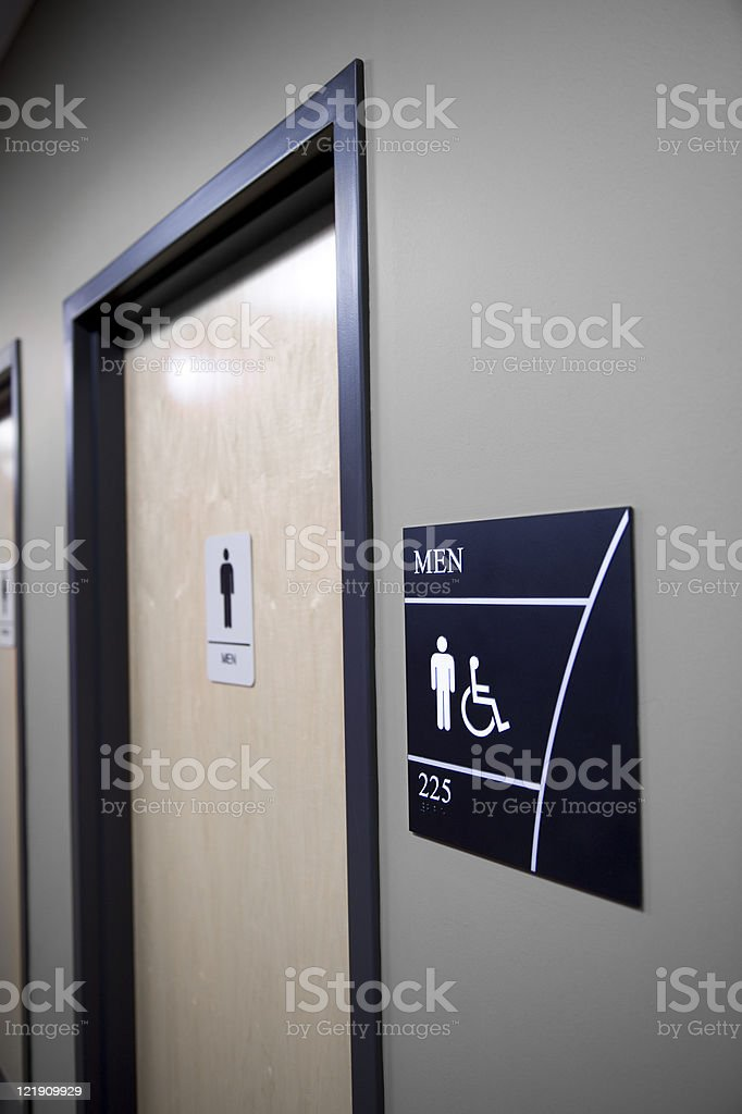 The door to a modern men's restroom royalty-free stock photo