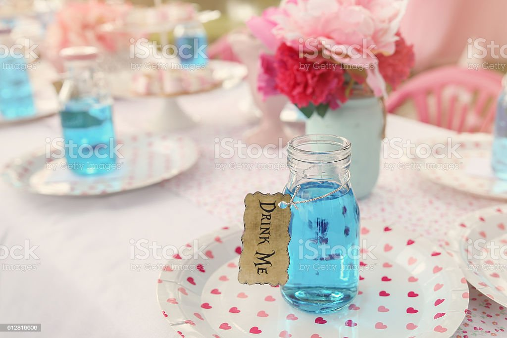 The 'Drink Me' potion, Alice in wonderland tea party theme stock photo